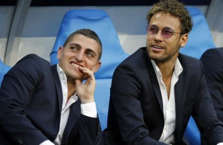 Brazilian PSG player Neymar, right, and Italy's Marco Verratti look away before the French Cup soccer final Paris Saint Germain against Les Herbiers at the Stade de France stadium in Saint-Denis, outside Paris, Tuesday, May 8, 2018. (AP Photo/Francois Mori)