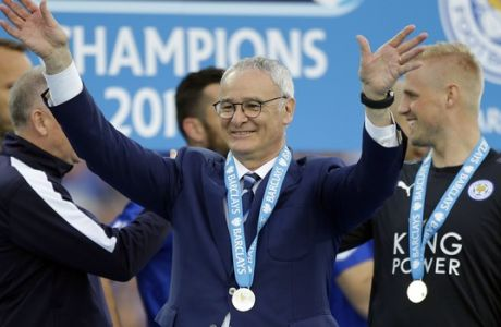 FILE - In this Saturday, May 7, 2016 file photo, Leicester's team manager Claudio Ranieri waves as Leicester City celebrate becoming the English Premier League soccer champions at King Power stadium in Leicester, England. Leicester is one of two newcomers in Europes elite club competition, the Champions League, this season, along with Rostov following its second-place finish in the Russian league. (AP Photo/Matt Dunham, File)