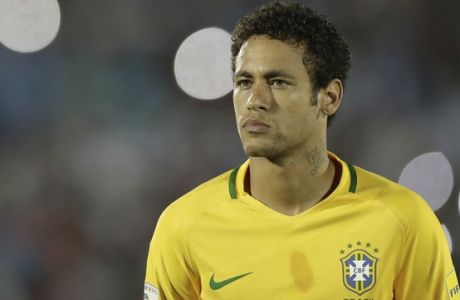 Brazil's Neymar looks on as the national anthems are sung prior a 2018 World Cup qualifying soccer match between Brazil and Uruguay in Montevideo, Uruguay, Thursday, March. 23, 2017.(AP Photo/Natacha Pisarenko)
