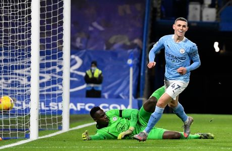 Manchester City's Phil Foden celebrates after scoring his side's second goal during the English Premier League soccer match between Chelsea and Manchester City at Stamford Bridge, London, England, Sunday, Jan. 3, 2021. (AP Photo/Ian Walton/Pool)
