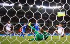 RECIFE, BRAZIL - JUNE 29:  Sokratis Papastathopoulos of Greece shoots and scores past goalkeeper Keylor Navas of Costa Rica during the 2014 FIFA World Cup Brazil Round of 16 match between Costa Rica and Greece at Arena Pernambuco on June 29, 2014 in Recife, Brazil.  (Photo by Paul Gilham/Getty Images)