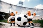 The official mascots for the 1974 World Cup, Tip and Tap, prepare to kick off on the centre spot of Munich's Olympiastadion, venue for the 1974 World Cup Final