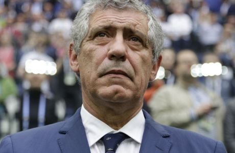 Portugal coach Fernando Santos waits for the kick-off of the Confederations Cup, Group A soccer match between New Zealand and Portugal, at the St. Petersburg Stadium, Russia, Saturday, June 24, 2017. (AP Photo/Ivan Sekretarev)