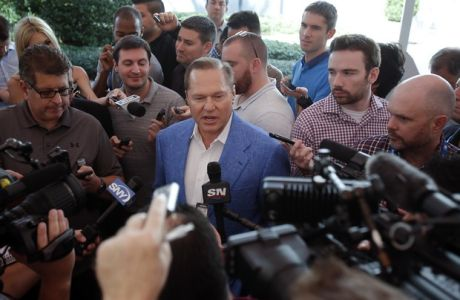 Sports agent Scott Boras answers questions during a news conference at the annual MLB baseball general managers' meetings, Wednesday, Nov. 15, 2017, in Orlando, Fla. (AP Photo/John Raoux)