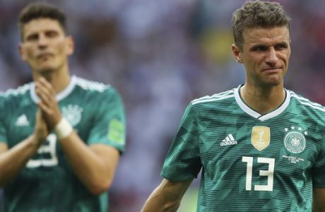 Germany's Thomas Mueller, right, and Mario Gomez walk on the pitch at the end of the group F match between South Korea and Germany, at the 2018 soccer World Cup in the Kazan Arena in Kazan, Russia, Wednesday, June 27, 2018. Defending champion Germany has been eliminated in the group stage of the World Cup in a 2-0 stoppage-time loss to South Korea and Sweden has topped Group F with a 3-0 win over Mexico. (AP Photo/Thanassis Stavrakis)