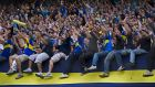 Boca Juniors fans cheer before an Argentine soccer league match against Belgrano in Buenos Aires, Argentina, Sunday, Oct. 16, 2011. (AP Photo/Victor R. Caivano)