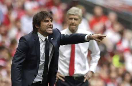 Chelsea team manager Antonio Conte, left, gestures as Arsenal team manager Arsene Wenger watches during the English FA Cup final soccer match between Arsenal and Chelsea at the Wembley stadium in London, Saturday, May 27, 2017. (AP Photo/Matt Dunham)