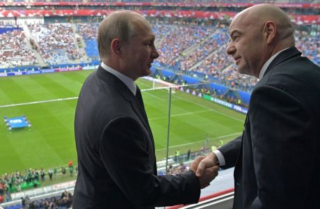 Russian President Vladimir Putin, left, and FIFA President Gianni Infantino shake hands before the Confederations Cup, Group A soccer match between Russia and New Zealand, at the St. Petersburg Stadium, in St. Petersburg, Russia, Saturday, June 17, 2017. The Confederations Cup has kicked off with host nation Russia opening the World Cup rehearsal tournament against New Zealand. (Alexei Druzhinin/Sputnik, Kremlin Pool Photo via AP)