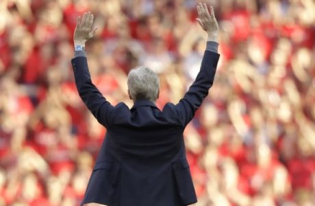 Arsenal's French manager Arsene Wenger waves to spectators before his lap of honor at the Emirates Stadium in London, Sunday, May 6, 2018. The match is Arsenal manager Arsene Wenger's last home game in charge after announcing in April he will stand down as Arsenal coach at the end of the season after nearly 22 years at the helm. (AP Photo/Matt Dunham)