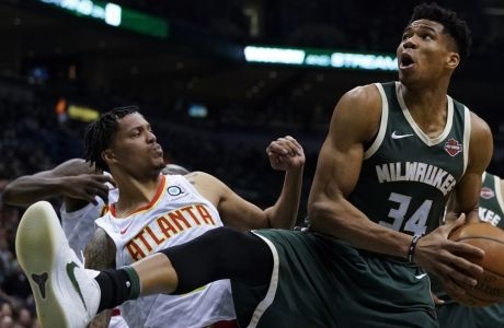Milwaukee Bucks' Giannis Antetokounmpo rebounds during the first half of an NBA basketball game against the Atlanta Hawks Saturday, March 17, 2018, in Milwaukee. (AP Photo/Morry Gash)