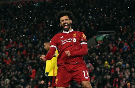Liverpool's Mohamed Salah celebrates scoring his hat-trick during the English Premier League soccer match between Liverpool and Watford at Anfield, Liverpool, England, Saturday, March 17, 2018. (Anthony Devlin/PA via AP)
