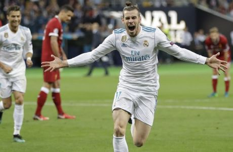 Real Madrid's Gareth Bale celebrates after scoring his side's second goal during the Champions League Final soccer match between Real Madrid and Liverpool at the Olimpiyskiy Stadium in Kiev, Ukraine, Saturday, May 26, 2018. (AP Photo/Sergei Grits)