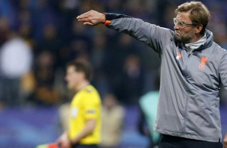 Liverpool coach Jurgen Klopp gives directions to his players during the Champions League soccer match between Maribor and Liverpool at the Ljudski vrt stadium, in Maribor, Slovenia, Tuesday, Oct. 17, 2017. (AP Photo/Darko Bandic)