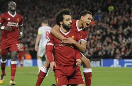 Liverpool's Mohamed Salah, front left, celebrates with Trent Alexander-Arnold after scoring his side's seventh goal during the Champions League Group E soccer match between Liverpool and Spartak Moscow at Anfield, Liverpool, England, Wednesday, Dec. 6, 2017. (AP Photo/Rui Vieira)