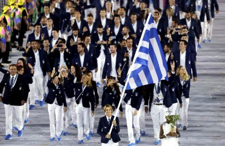 Sofia Bekatorou carries the flag of Greece during the opening ceremony for the 2016 Summer Olympics in Rio de Janeiro, Brazil, Friday, Aug. 5, 2016. (AP Photo/Matt Slocum)