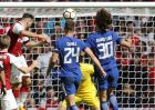 Arsenal's Sead Kolasinac, left, heads to score during the English Community Shield soccer match between Arsenal and Chelsea at Wembley Stadium in London, Sunday, Aug. 6, 2017. (AP Photo/Frank Augstein)