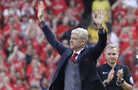 Arsenal's French manager Arsene Wenger waves before the English Premier League soccer match between Arsenal and Burnley at the Emirates Stadium in London, Sunday, May 6, 2018. The match is Arsenal manager Arsene Wenger's last home game in charge after announcing in April he will stand down as Arsenal coach at the end of the season after nearly 22 years at the helm. (AP Photo/Matt Dunham)