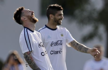 Argentina's Lionel Messi, left, laughs during a training session of the national soccer team before a 2018 Russia World Cup qualifying soccer match against Chile in Buenos Aires, Argentina, Tuesday, March 21, 2017.(AP Photo/Natacha Pisarenko)