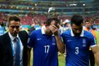 RECIFE, BRAZIL - JUNE 29:  Theofanis Gekas (C) and Giorgos Tzavellas (R) of Greece walk off the pitch after the defeat in the 2014 FIFA World Cup Brazil Round of 16 match between Costa Rica and Greece at Arena Pernambuco on June 29, 2014 in Recife, Brazil.  (Photo by Ryan Pierse - FIFA/FIFA via Getty Images)