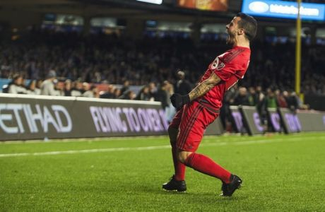 Toronto FC Sebastian Giovinco (10) celebrates his goal during a MLS second leg eastern semifinals soccer match against New York City FC at Yankee stadium, in New York, Sunday, Nov. 6, 2016. (AP Photo/Andres Kudacki)