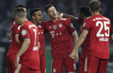 Bayern's Robert Lewandowski, center, celebrates with team mates after scoring his side's opening goal during the German soccer cup final match between FC Bayern Munich and Eintracht Frankfurt in Berlin, Germany, Saturday, May 19, 2018. (AP Photo/Michael Sohn)