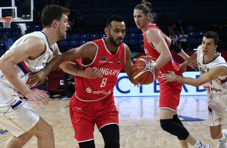 Hungary's Adam Hanga, second from left, drives to the basket as Serbia's Ognjen Kuzmic tries to block him during their Eurobasket European Basketball Championship round of 16 match in Istanbul, Sunday, Sept. 10. 2017. (AP Photo/Lefteris Pitarakis)