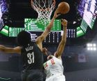 Brooklyn Nets' Jarrett Allen blocks a shot by Milwaukee Bucks' Giannis Antetokounmpo during the first half of an NBA basketball game Saturday, Dec. 29, 2018, in Milwaukee. (AP Photo/Morry Gash)