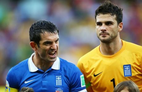 RECIFE, BRAZIL - JUNE 29:  Giorgos Karagounis and Orestis Karnezis of Greece look on prior to the 2014 FIFA World Cup Brazil Round of 16 match between Costa Rica and Greece at Arena Pernambuco on June 29, 2014 in Recife, Brazil.  (Photo by Paul Gilham/Getty Images)