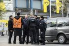 Police officers stand outside the Signal Iduna Park stadium in Dortmund, Germany, Wednesday, April 12, 2017, the day after the team bus was damaged in an explosion which injured a player and a police officer. (Marcel Kusch/dpa via AP)