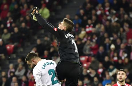 Athletic Bilbao's goalkeeper Kepa Arrizabalaga, pushes the ball beside Real Madrid's Daniel Carvajal during the Spanish La Liga soccer match between Athletic Bilbao and Real Madrid at San Mames stadium, in Bilbao, northern Spain, Saturday, Dec. 2, 2017. (AP Photo/Alvaro Barrientos)