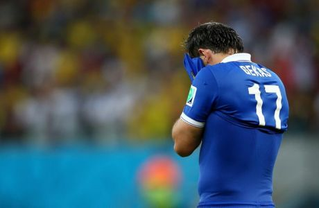 RECIFE, BRAZIL - JUNE 29: Theofanis Gekas of Greece looks dejected after being defeated by Costa Rica in a penalty shootout during the 2014 FIFA World Cup Brazil Round of 16 match between Costa Rica and Greece at Arena Pernambuco on June 29, 2014 in Recife, Brazil.  (Photo by Paul Gilham/Getty Images)