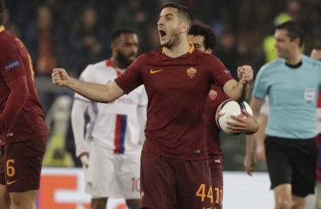 Roma's Kostas Manolas, right, celebrates his sides second goal during the Europa League round of 16 second leg soccer match between Roma and Lyon, in Rome's Olympic stadium, Thursday, March 16, 2017. (AP Photo/Andrew Medichini)