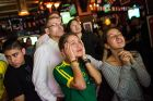 NEW YORK, NY - JUNE 12:  Brazilian soccer fans watch the Brazil vs. Croatia World Cup game at Legends Bar on June 12, 2014 in New York City. Brazil vs Croatia is the first game of the World Cup, which will take place throughout Brazil until Sunday, July 13.  (Photo by Andrew Burton/Getty Images)