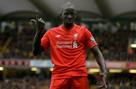 Liverpool's Mamadou Sakho gestures at one of the assistant referees during the English Premier League soccer match between Watford and Liverpool at Vicarage Road stadium in Watford, Sunday, Dec. 20, 2015. (AP Photo/Matt Dunham)