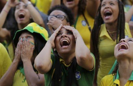 Brazilian soccer fans react as they watch a live telecast of her team's World Cup match against Serbia, at Praca Maua, in Rio de Janeiro, Brazil, Wednesday, June 27, 2018. Brazil wn 2-0. (AP Photo/Silvia Izquierdo)