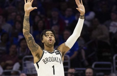 Brooklyn Nets' D'Angelo Russell reacts during the second half in Game 1 of a first-round NBA basketball playoff series against the Philadelphia 76ers, Saturday, April 13, 2019, in Philadelphia. Nets won 111-102. (AP Photo/Chris Szagola)