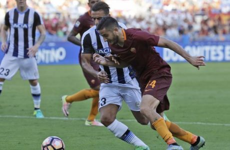 Romas Kostas Manolas, right, is challenged by Udinese's Kadhim Ali Adnan during a Serie A soccer match at Rome's Olympic stadium, Saturday, Aug. 20, 2016. (AP Photo/Alessandra Tarantino)