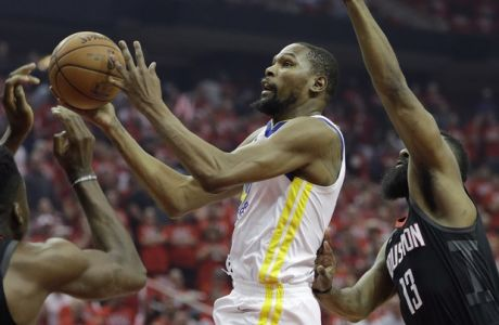 Golden State Warriors forward Kevin Durant (35) drives to the basket past Houston Rockets guard James Harden (13) during the first half of Game 1 of the NBA basketball Western Conference Finals, Monday, May 14, 2018, in Houston. (AP Photo/David J. Phillip)