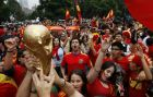 Fans of Spain national soccer team celebrate in Mexico City after their team defeated The Netherlands 1-0 during the South Africa 2010 World Cup final match Sunday, July 11, 2010. Spain became the new world soccer champion for the first time in the tournament's history.  (AP Photo/Marco Ugarte)