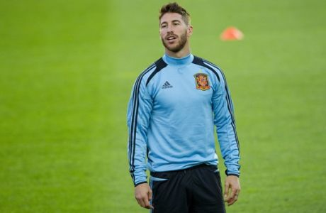 Spanish national soccer team player  Sergio Ramos during a training session  in Helsinki, Finland Thursday  Sept. 5, 2013. Spain will face Finland in the FIFA World Cup 2014 qualifying soccer match on Friday. (AP Photo / LEHTIKUVA / Jarno Mela )