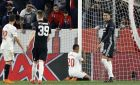 Sevilla's Luis Muriel on his knees reacts after failing to score during the Champions League round of sixteen first leg soccer match between Sevilla FC and Manchester United at the Ramon Sanchez Pizjuan stadium in Seville, Spain, Wednesday, Feb. 21, 2018. (AP Photo/Miguel Morenatti)