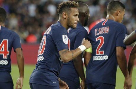 PSG's Neymar, center, celebrates the opening goal during their League One soccer match between Paris Saint-Germain and Caen at Parc des Princes stadium in Paris, Sunday, Aug. 12, 2018. (AP Photo/Michel Euler)