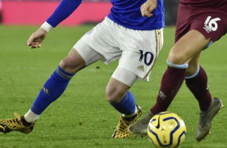 Leicester's James Maddison, left, and West Ham's Mark Noble challenge for the ball during the English Premier League soccer match between Leicester City and West Ham Utd at the King Power Stadium in Leicester, England, Wednesday, Jan. 22, 2020. (AP Photo/Rui Vieira)
