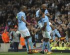 Manchester City's Raheem Sterling celebrates with teammates after scoring his sides second goal of the game during the Champions League Group F soccer match between Manchester City and Shakhtar Donetsk at Etihad stadium, Manchester, England, Tuesday, Sept. 26, 2017.City won the game 2-0. (AP Photo/Rui Vieira)