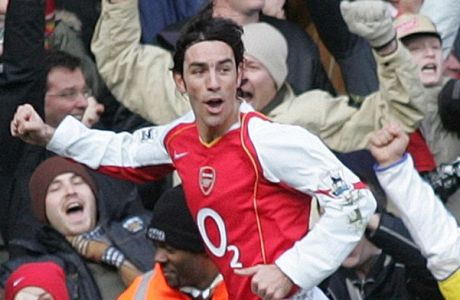 Arsenal's Robert Pires celebrates scoring against Sheffield United during their fifth round FA Cup soccer match at Arsenal's Highbury ground in London, Saturday Feb. 19, 2005. The match ended in a 1-1 draw. (AP Photo/Alastair Grant)
