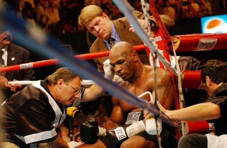 Mike Tyson in his corner after losing to England's Danny Williams in their heavyweight contest at the Freedom Hall in Louisville, Kentucky, Friday July 30,  2004. Tyson was knocked out by Williams in the fourth round.  ( AP Photo/PA, Sean Dempsey ) ** UNITED KINGDOM OUT  MAGS OUT  NO SALES **