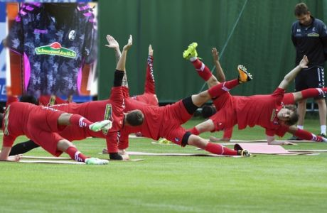 Freiburg's players warm up during their first training session of the season of Bundesliga soccer club SC Freiburg, at the Schwarzwald Stadium in Freiburg, Germany, Monday, July 3,  2017.  (Uli Deck/dpa via AP)