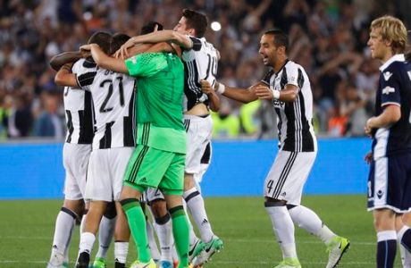 Juventus players celebrate their 2-0 win at the end of the Italian Cup soccer final match between Lazio and Juventus, at Rome's Olympic stadium, Wednesday, May 17, 2017. (AP Photo/Gregorio Borgia)
