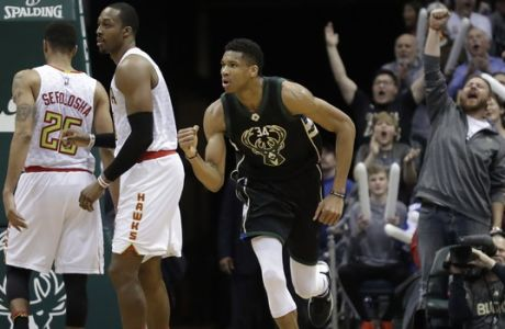 Milwaukee Bucks' Giannis Antetokounmpo reacts after making a shot in the final minutes of the second half of an NBA basketball game against the Atlanta Hawks Friday, March 24, 2017, in Milwaukee. The Bucks won 100-97. (AP Photo/Morry Gash)