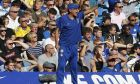 Chelsea's team manager Maurizio Sarri gestures during the English Premier League soccer match between Chelsea and Bournemouth at Stamford Bridge stadium in London, Saturday, Sept. 1, 2018. (AP Photo/Frank Augstein)